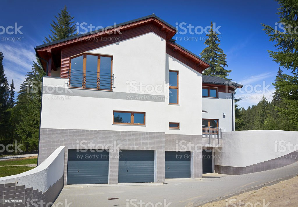 New residential home in the forest royalty-free stock photo