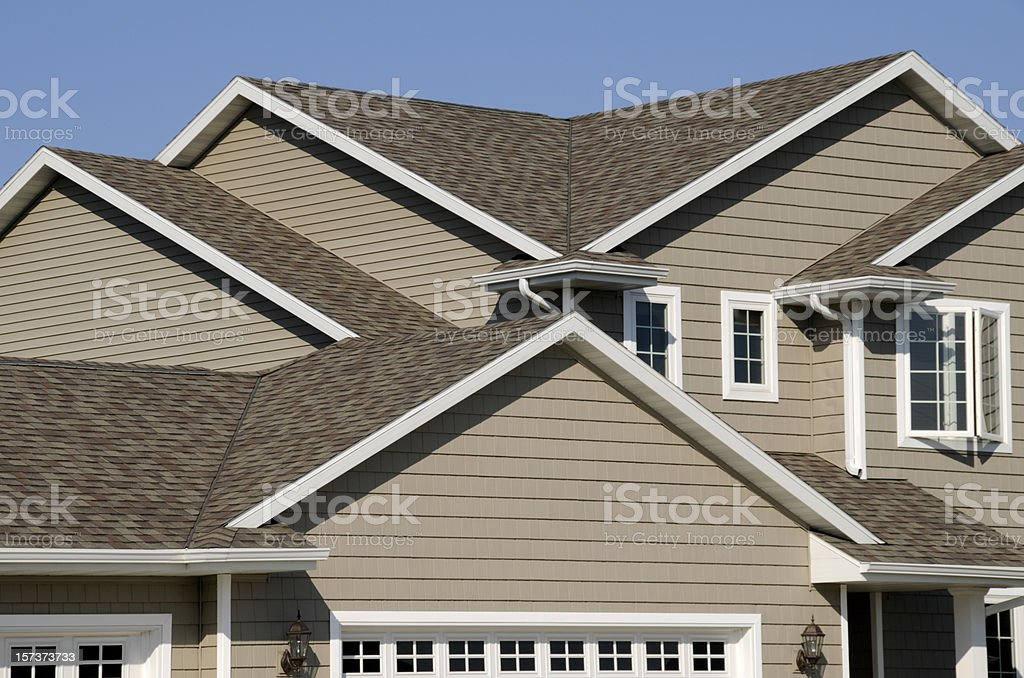 New Residential House; Architectural Asphalt Shingle Gable Roof, Vinyl Siding stock photo