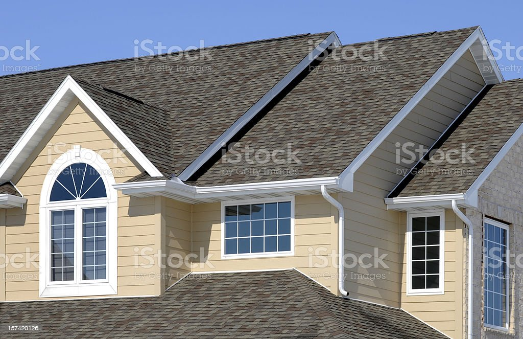 New Residential House; Architectural Asphalt Shingle Roof, Vinyl Siding, Gables royalty-free stock photo