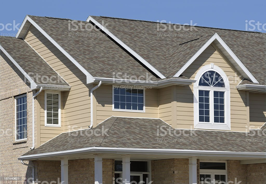 New Residential House; Architectural Asphalt Shingle Roof, Vinyl Siding stock photo