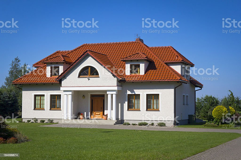 New residential House with red roof tile in the suburbs royalty-free stock photo