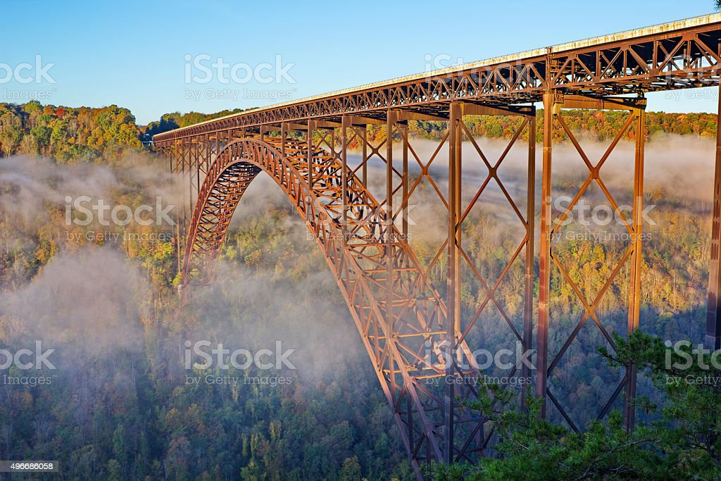 New River Gorge Bridge in Foggy Morning Fall Color stock photo
