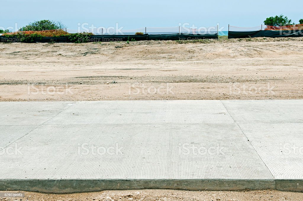 New road next to beach in growing city of Ewa stock photo