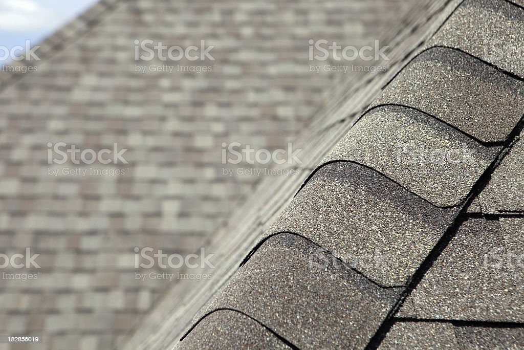 New Roof Cap Leads to Valley and Blurred Shingles stock photo