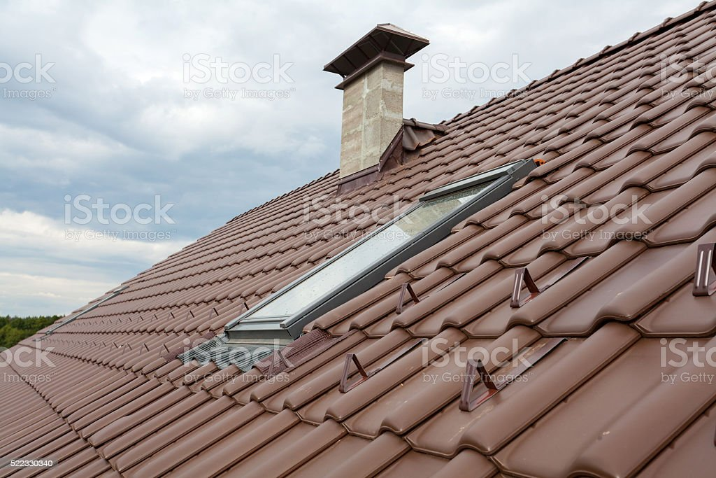 New roof with skylight, natural red tile and chimney stock photo