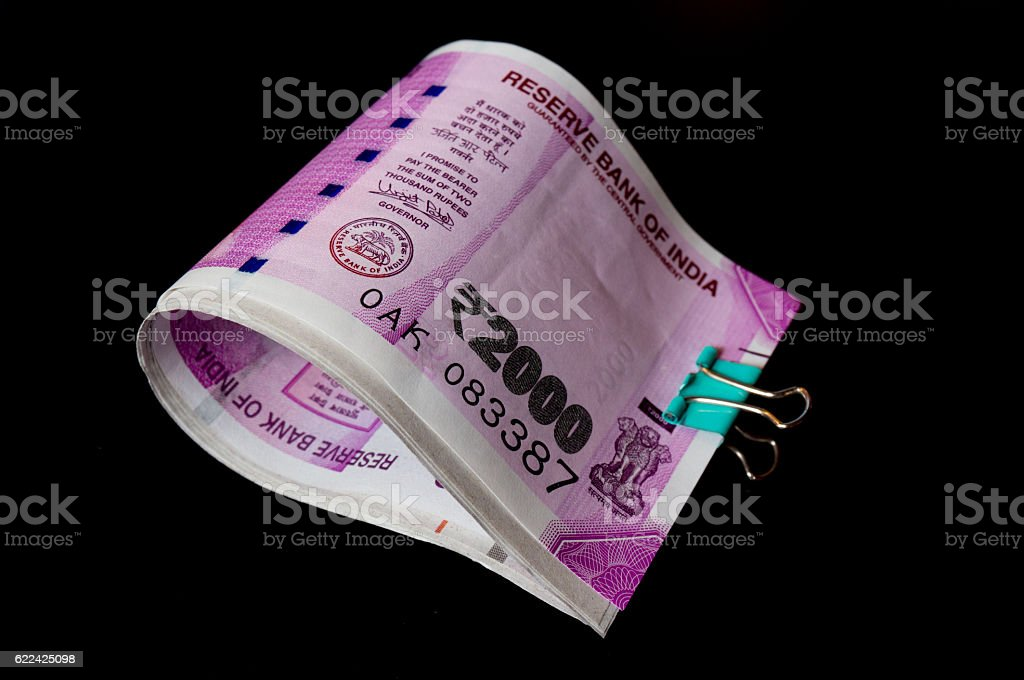 New rupee 2000 notes clipped and isolated on black stock photo