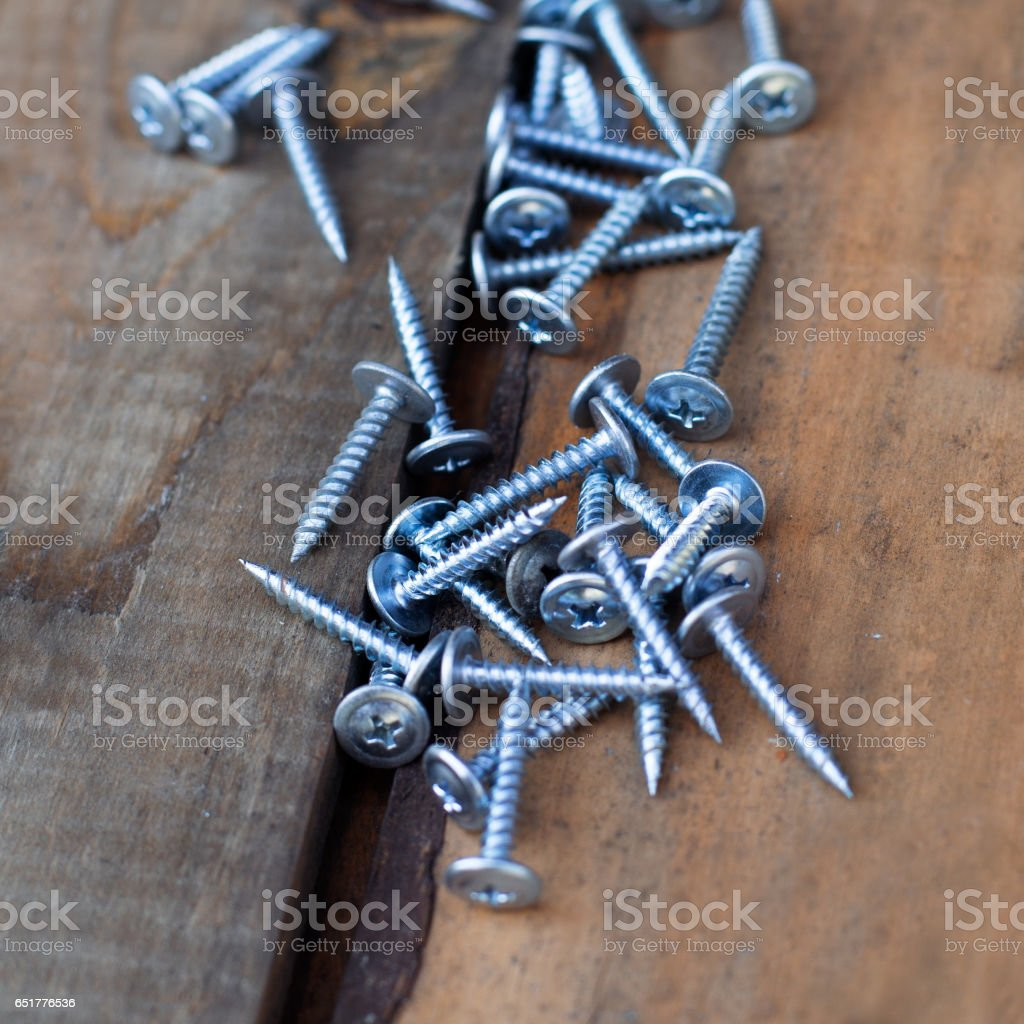 new screws on old wooden boards stock photo