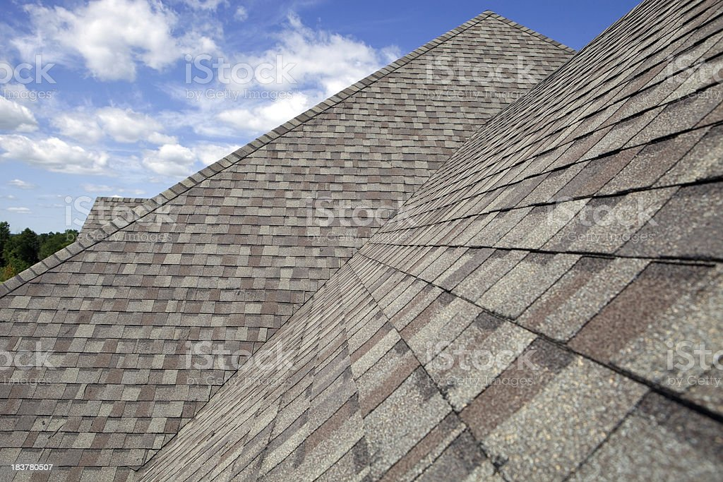 New Shingled Roof with Blue Sky Background stock photo