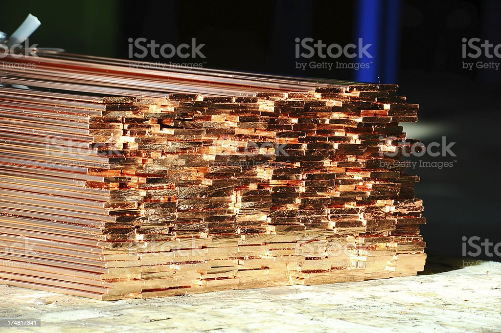 New shiny copper rods in a metal factory stock photo
