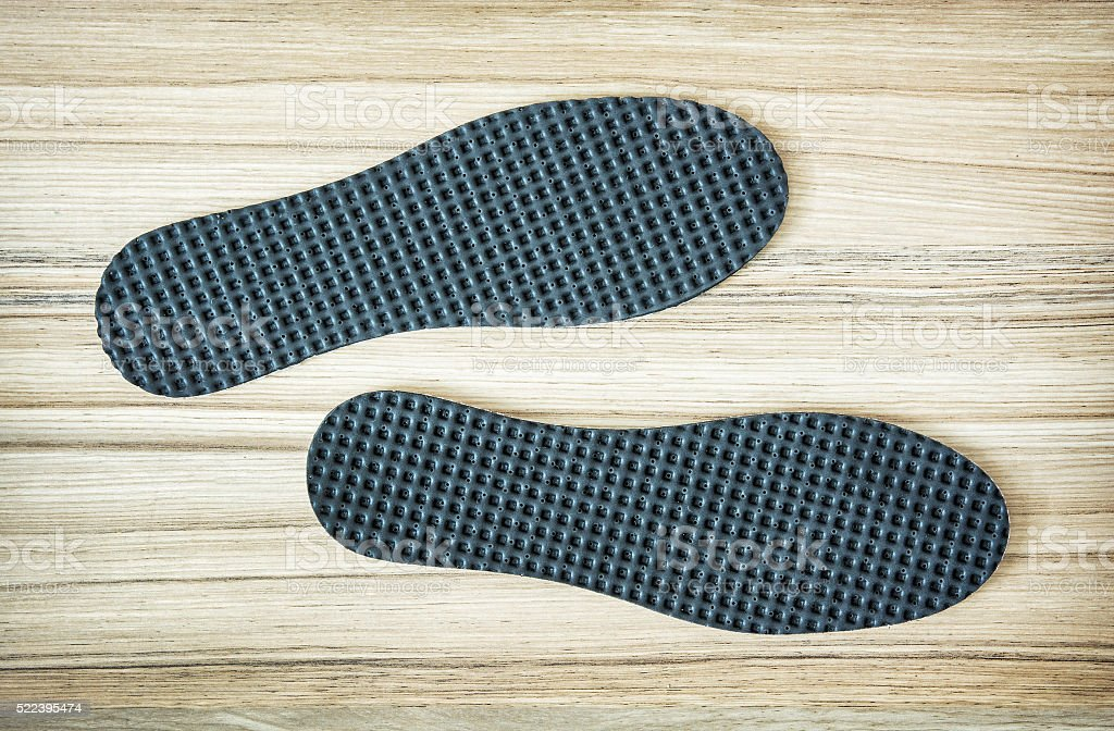 New shoe insoles on the wooden background stock photo