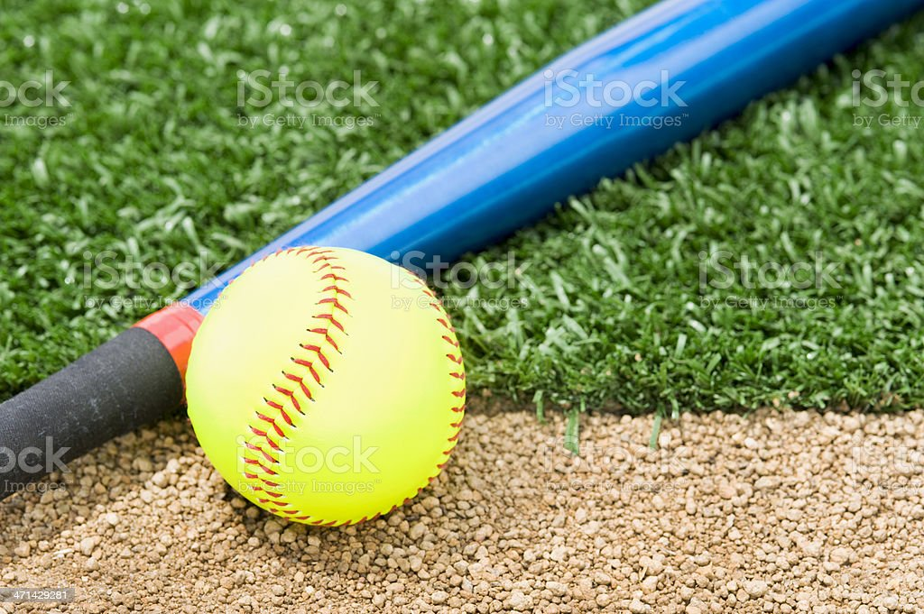 A New \'Fast Pitch\' Softball and an aluminum bat sitting between the...