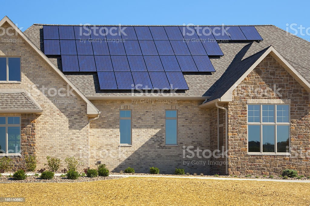 New Solar Powered Brick and Stone House stock photo