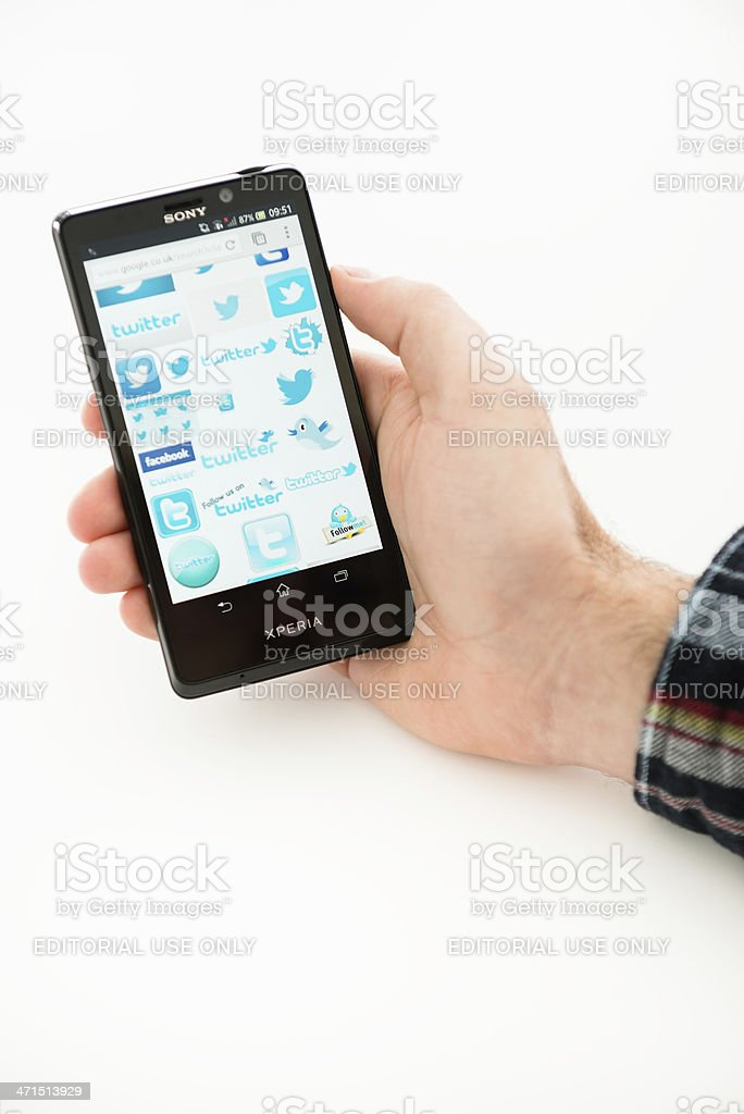 new Sony xperia T with twitter icons on the screen royalty-free stock photo