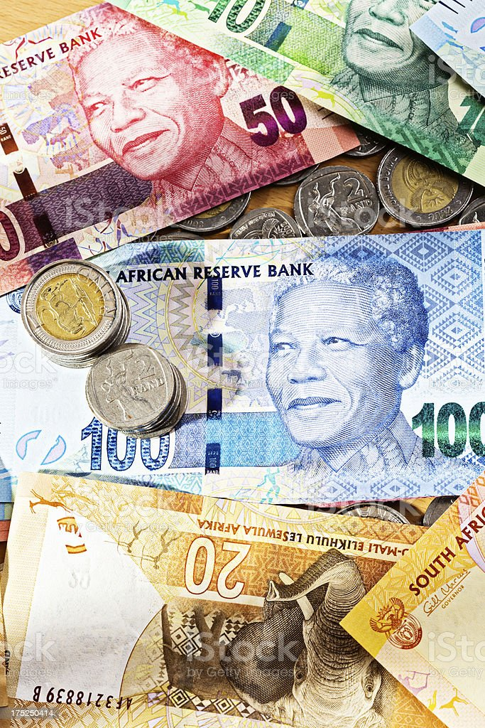 New South African banknotes and coins scattered on desk top stock photo