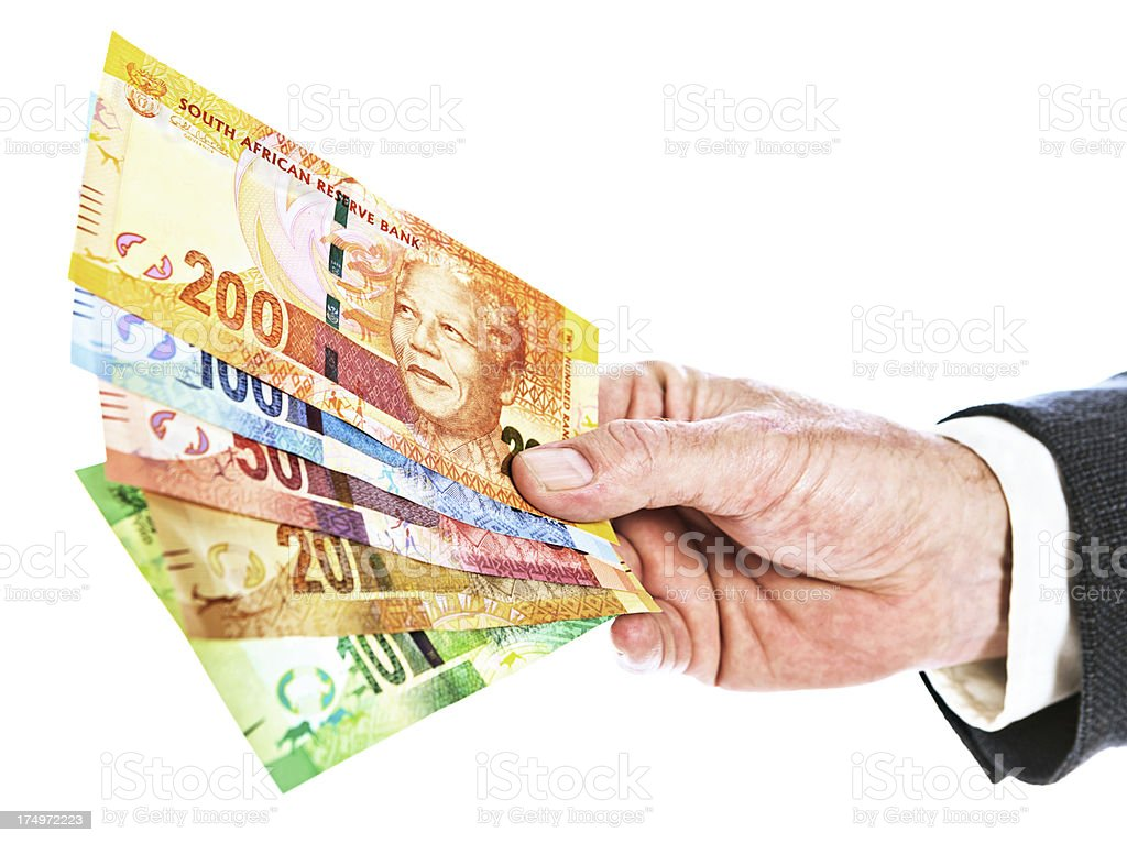 New South African banknotes featuring Nelson Mandela in male hand stock photo