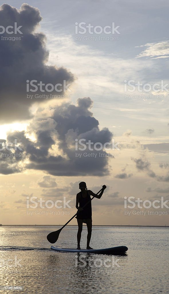 New Sports Trend Paddle Boarding at Sunset royalty-free stock photo