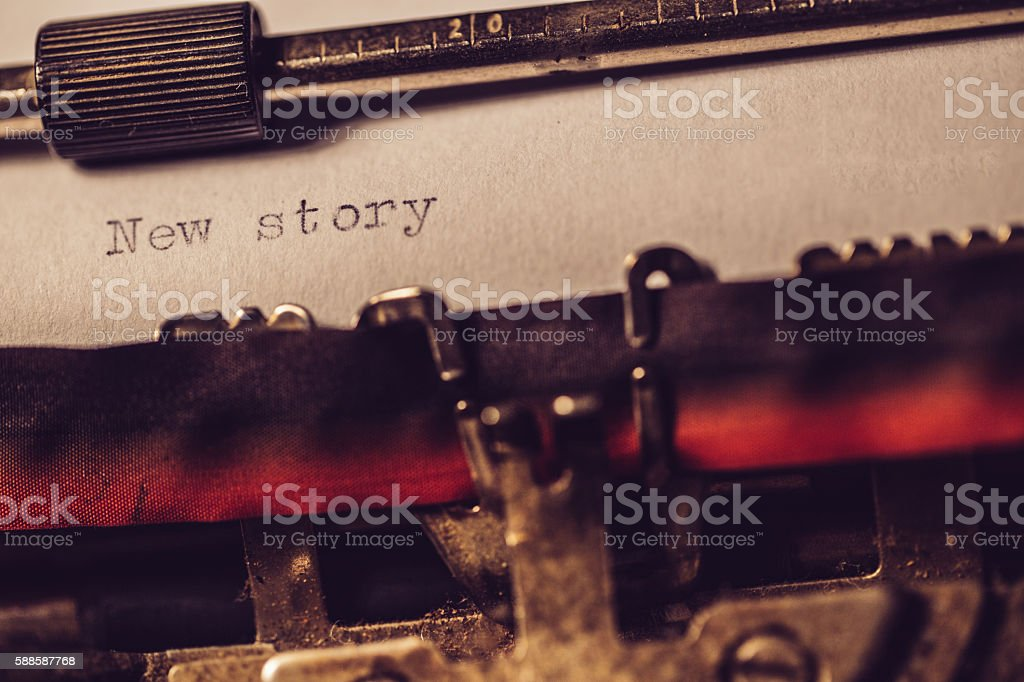 'New story' typed using an old typewriter stock photo