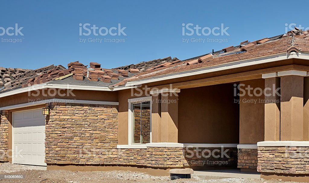 New stucco and brick home construction housing industry stock photo