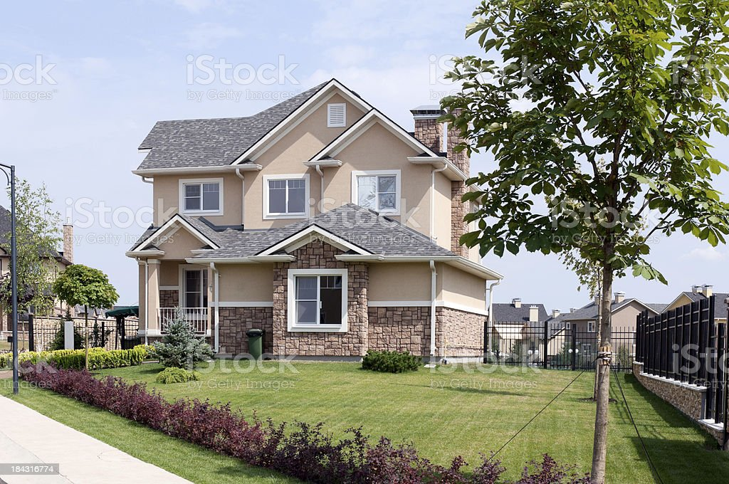 New suburban two story home on sunny summer afternoon royalty-free stock photo
