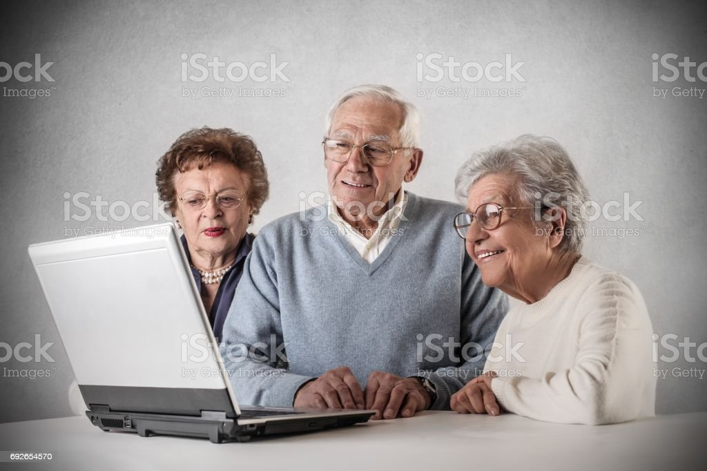 Old people are looking at a laptop