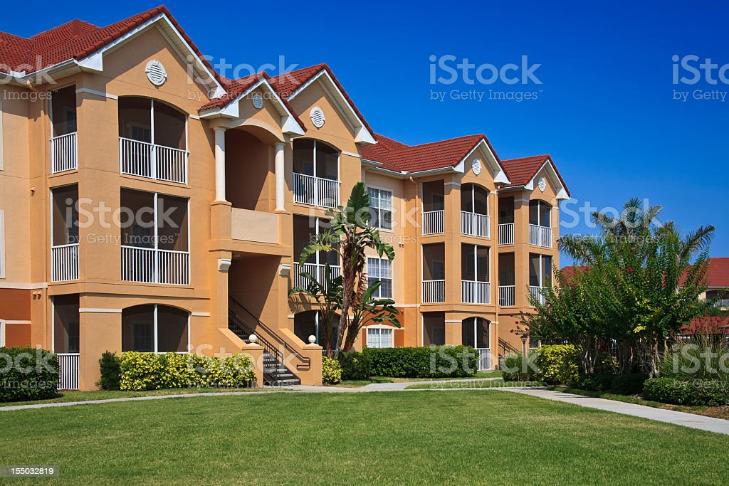 New three story condominiums surrounded by green landscape royalty-free stock photo