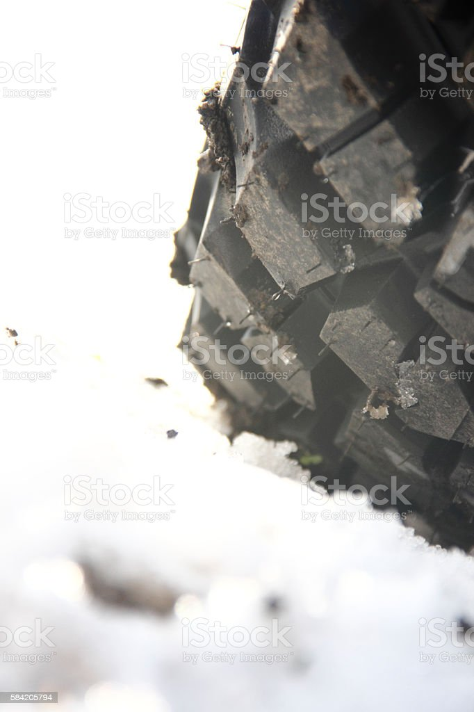 New tire covered with snow stock photo