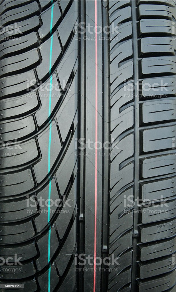 New tire tread with visible markings royalty-free stock photo