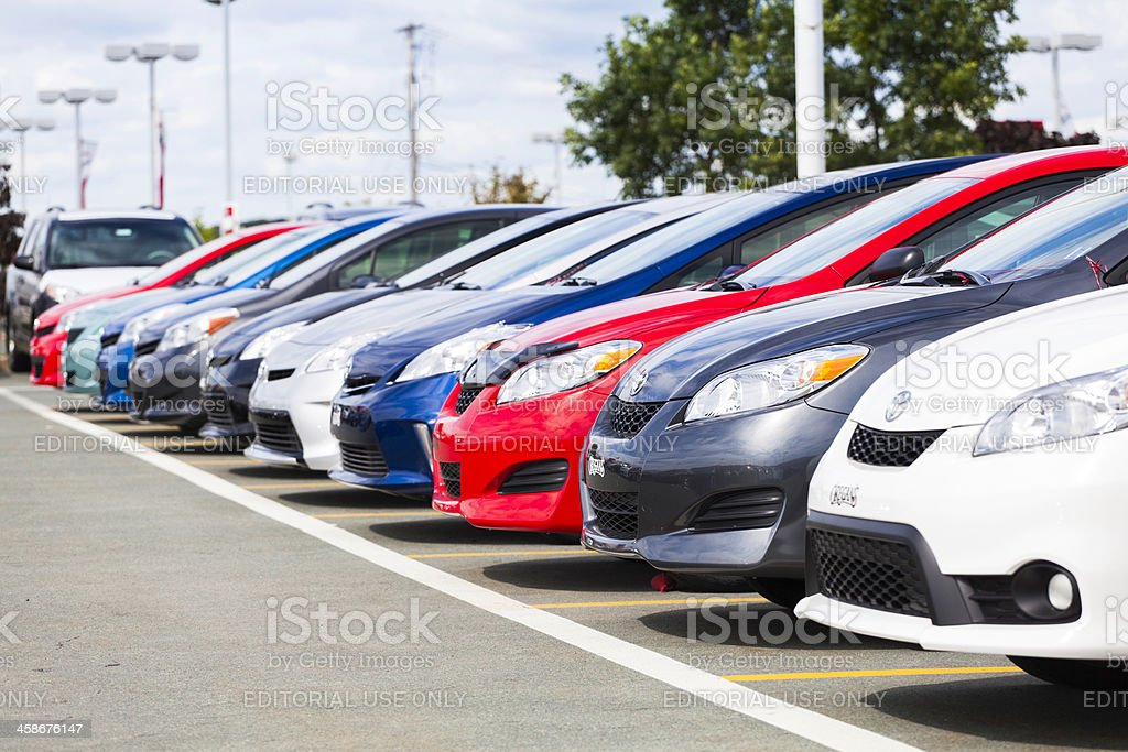 New Toyota Vehicles in a Row at Car Dealership stock photo