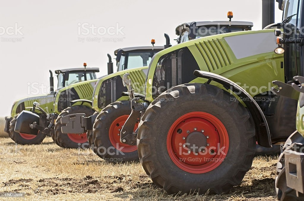 New tractors on field stock photo