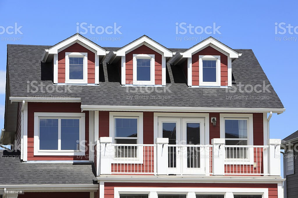 New Two Story Home With Dormer Windows royalty-free stock photo