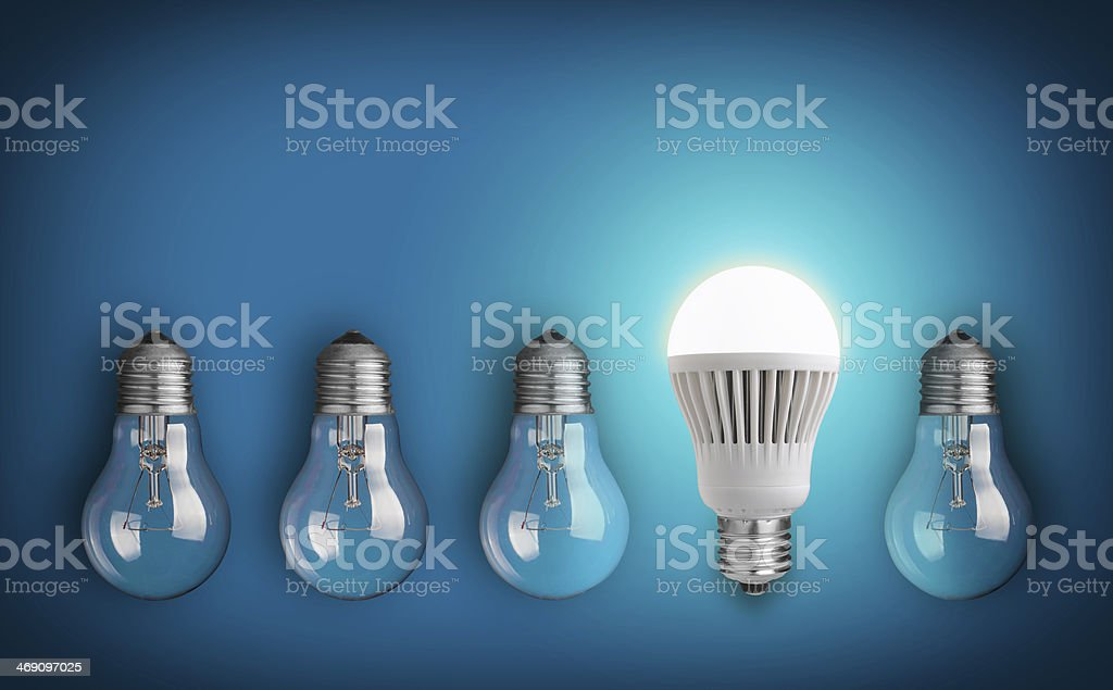 A new type of light bulb amongst old ones stock photo