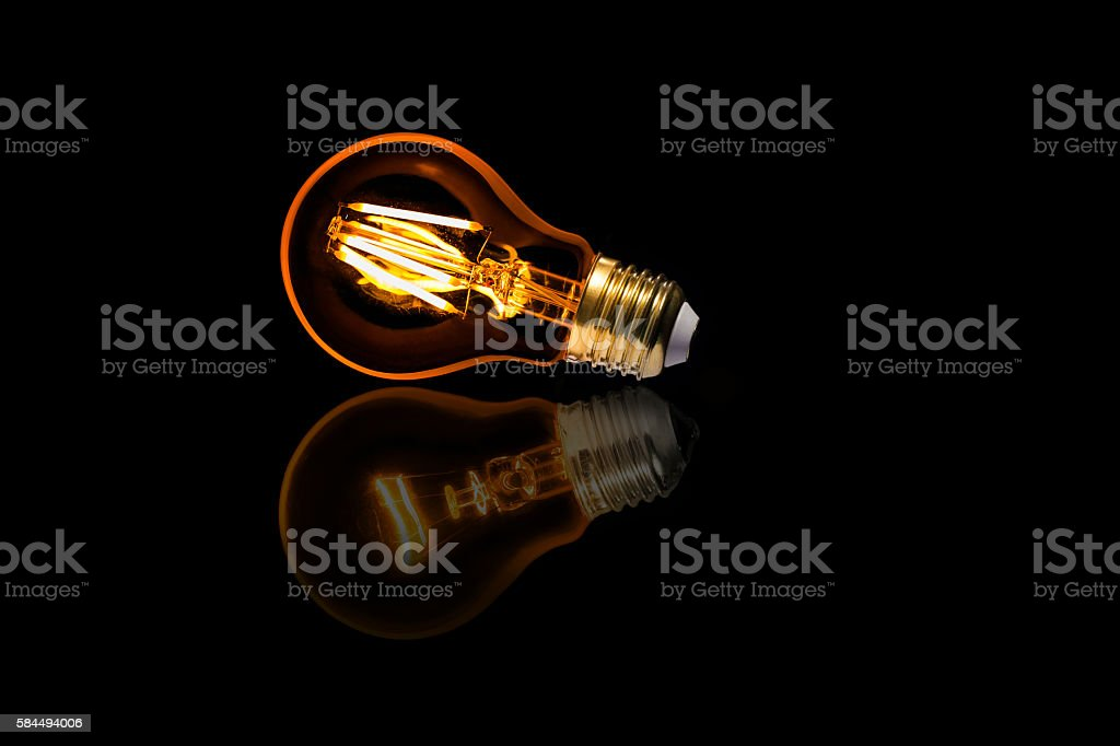 New vintage LED lights bulb shadow to old light bulb stock photo