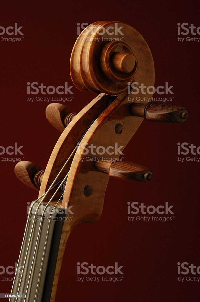 New Violin Scroll and Rosewood Tuning Pegs on Red royalty-free stock photo