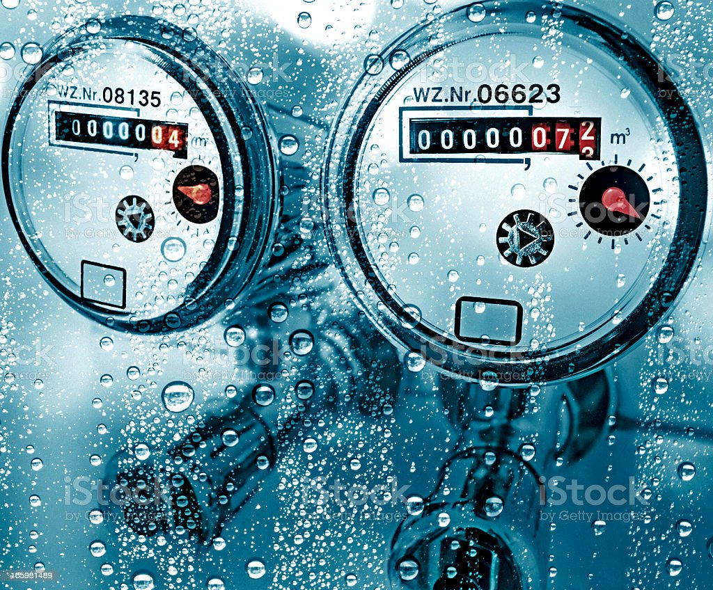 New water counter / meter behind a wet window stock photo