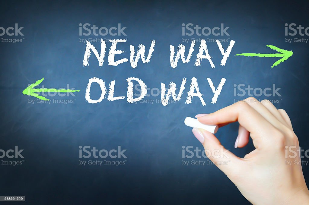 New way versus the old way concept stock photo