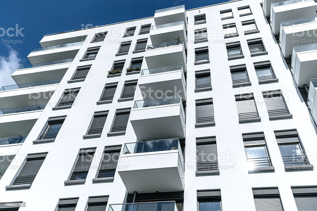 New white apartment house with balconies stock photo