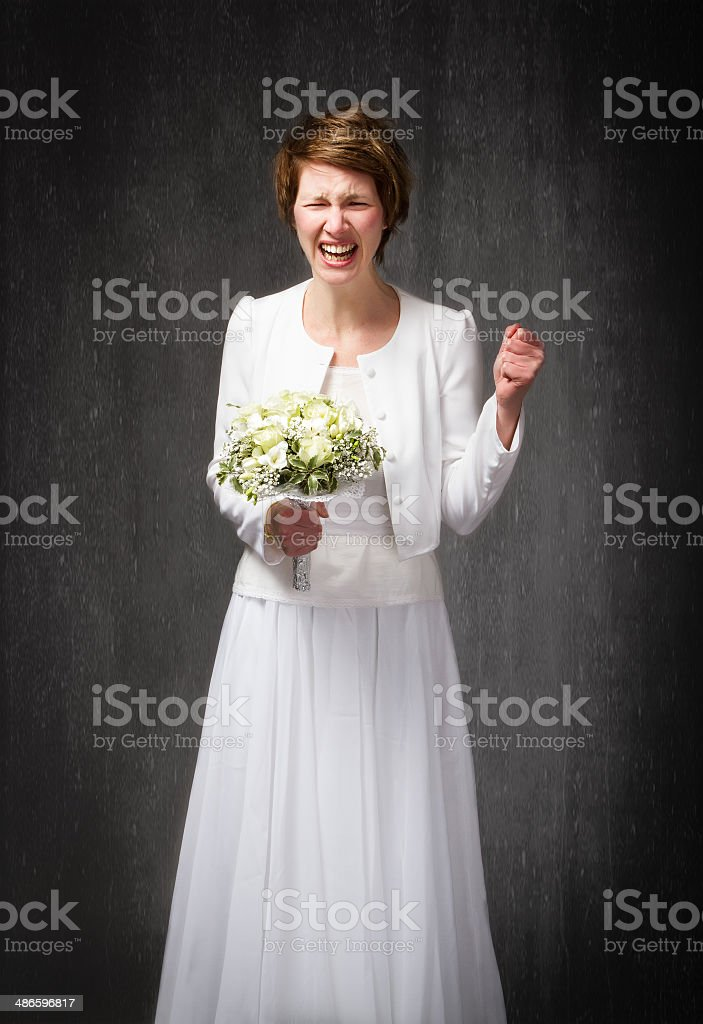 new wife desperation on white wedding dress stock photo
