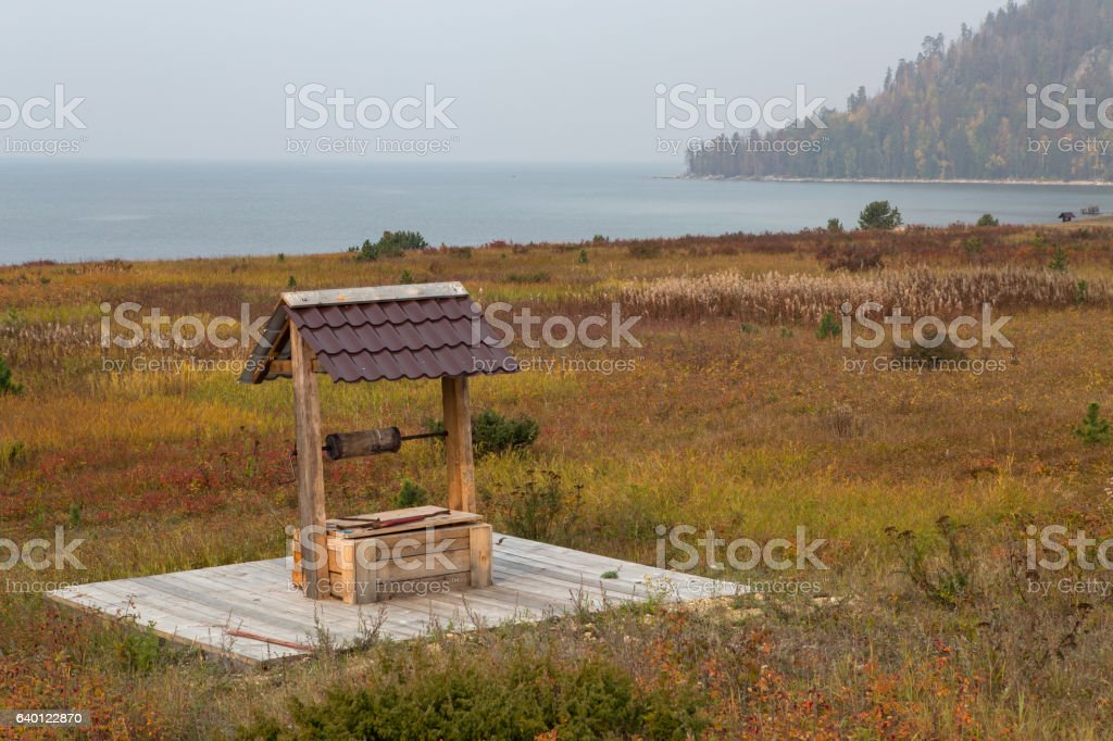 New wooden well with lifting winch. stock photo
