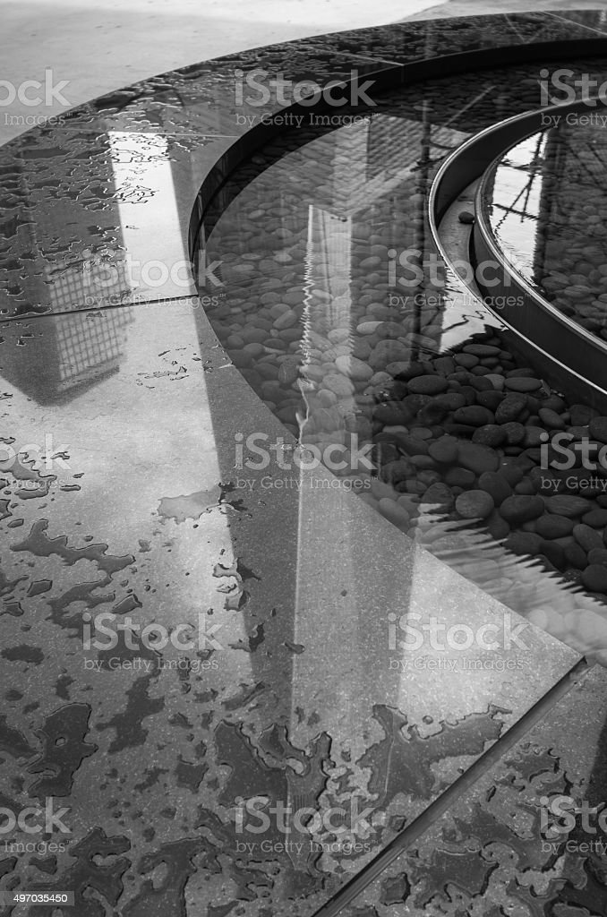 New World Trade Center reflecting in fountain stock photo