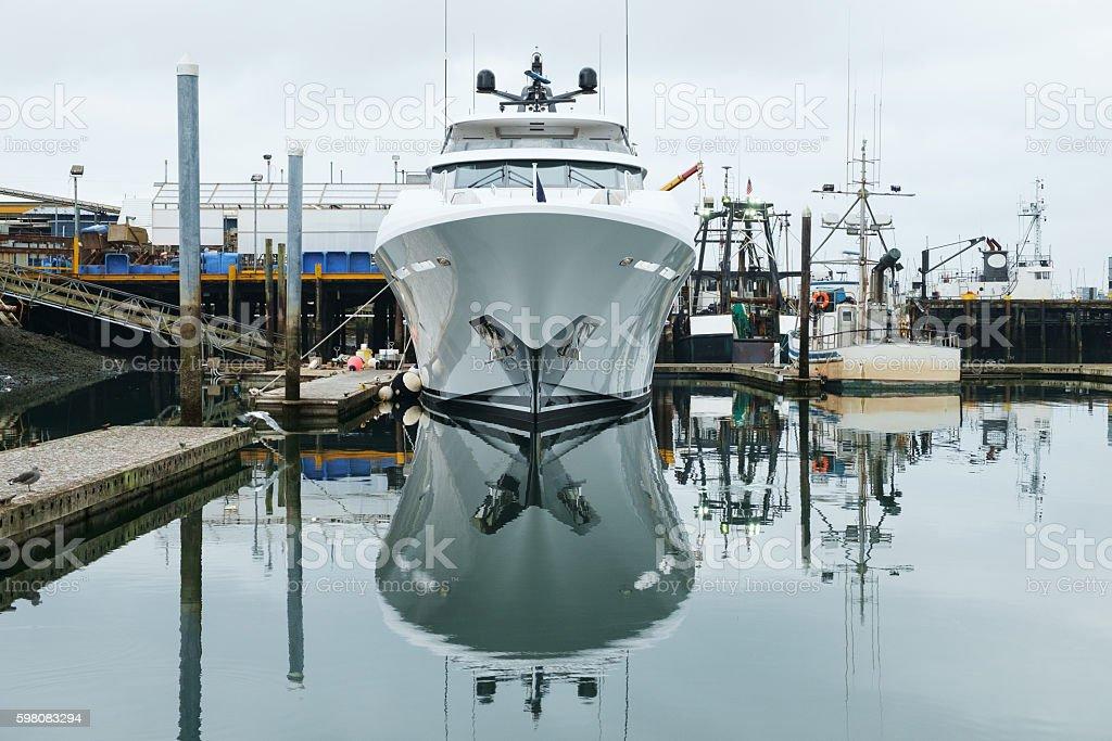 New yacht in marina stock photo