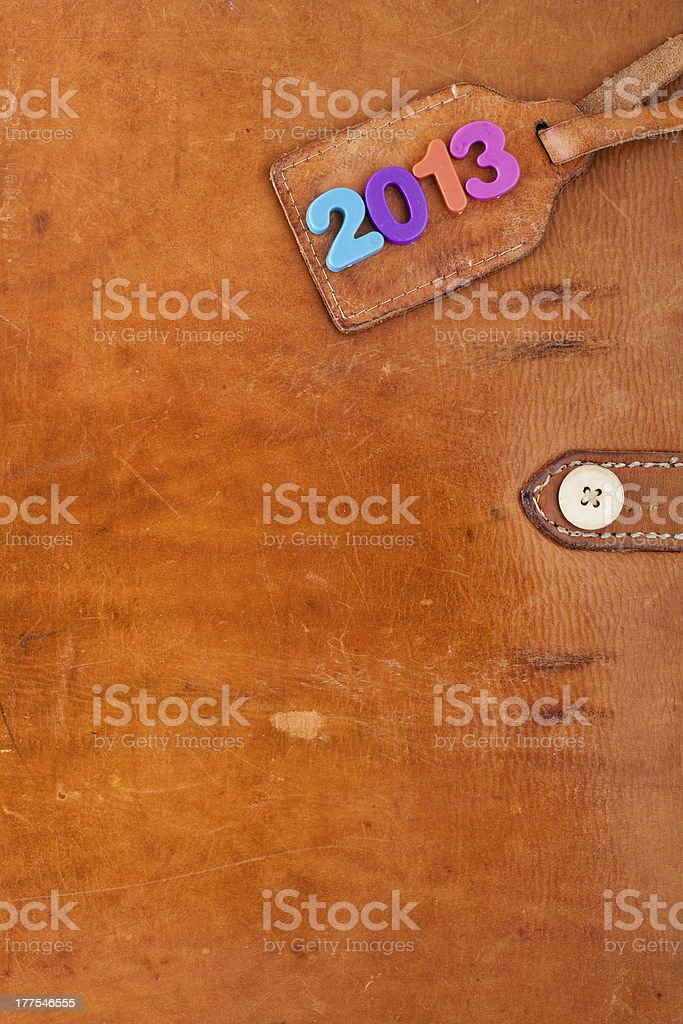 New Year 2013 date label on vintage leather textured background royalty-free stock photo