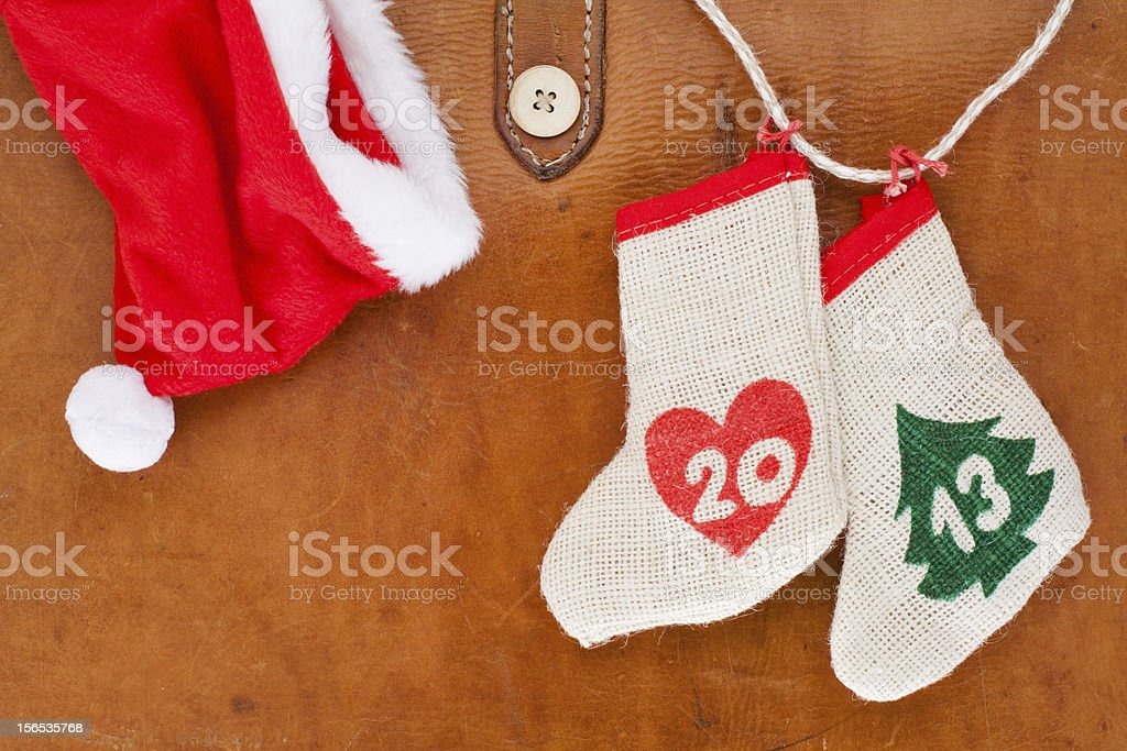 New Year 2013 date, red Santa cap on old leather royalty-free stock photo