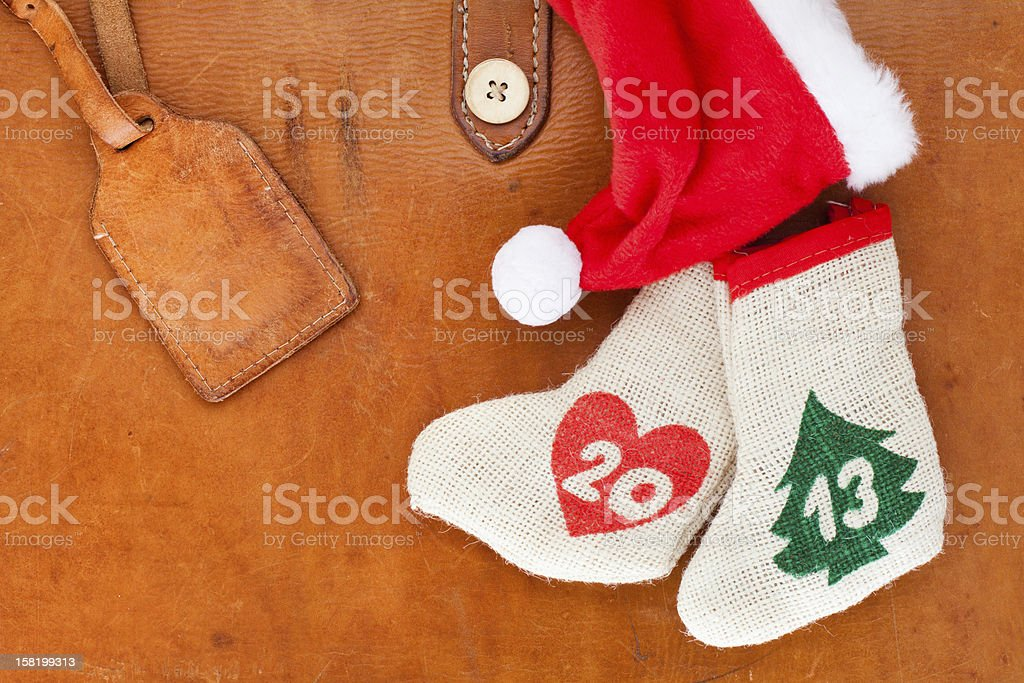 New Year 2013 date stocking, Santa cap on vintage leather royalty-free stock photo