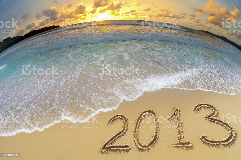 new year 2013 digits on ocean beach sand royalty-free stock photo