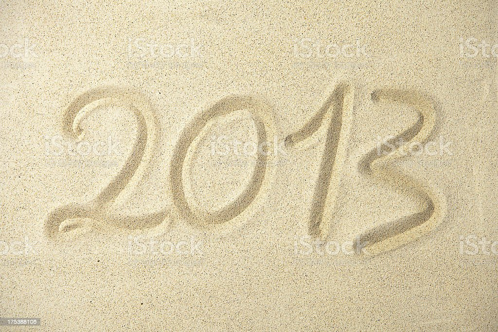 New year 2013 written on sand royalty-free stock photo