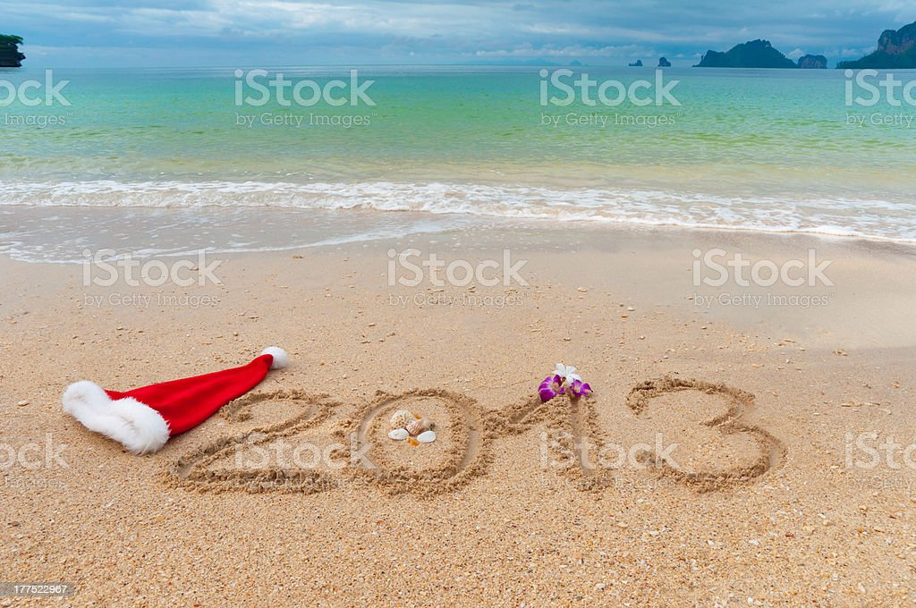 New year 2013 written on tropical beach sand royalty-free stock photo