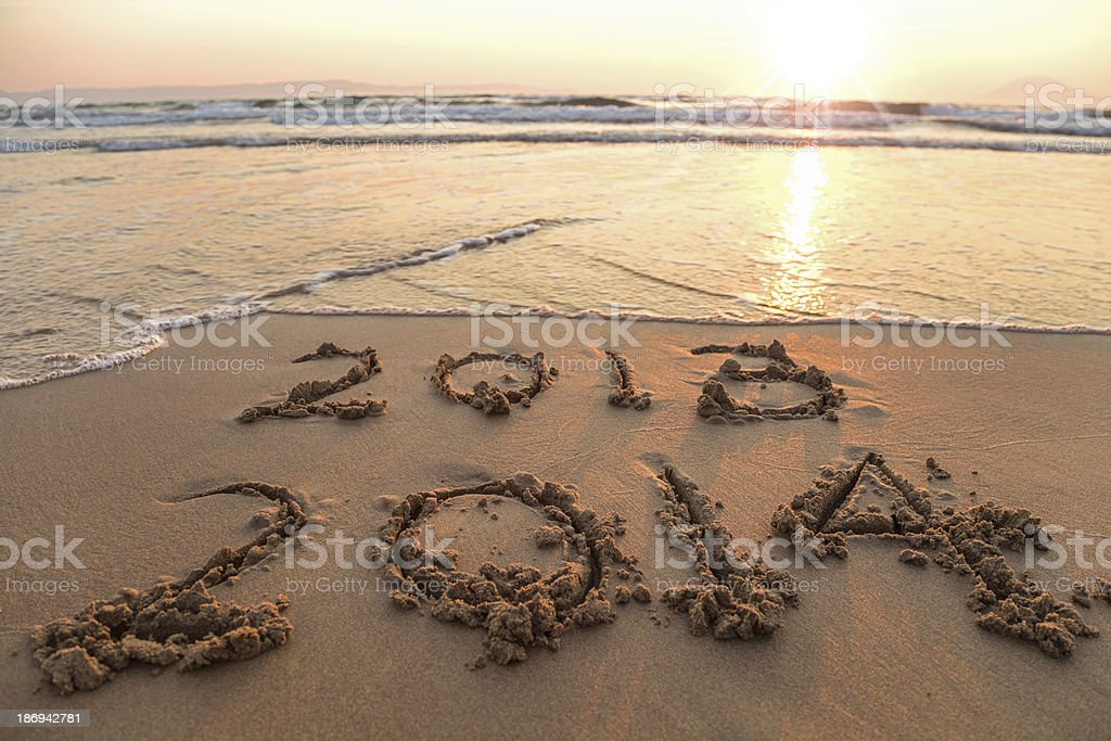 New year 2014 on sand stock photo