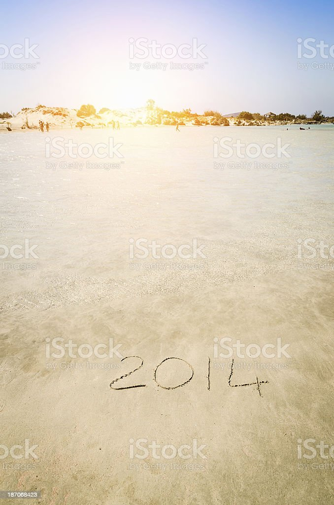 New year 2014 on the beach royalty-free stock photo