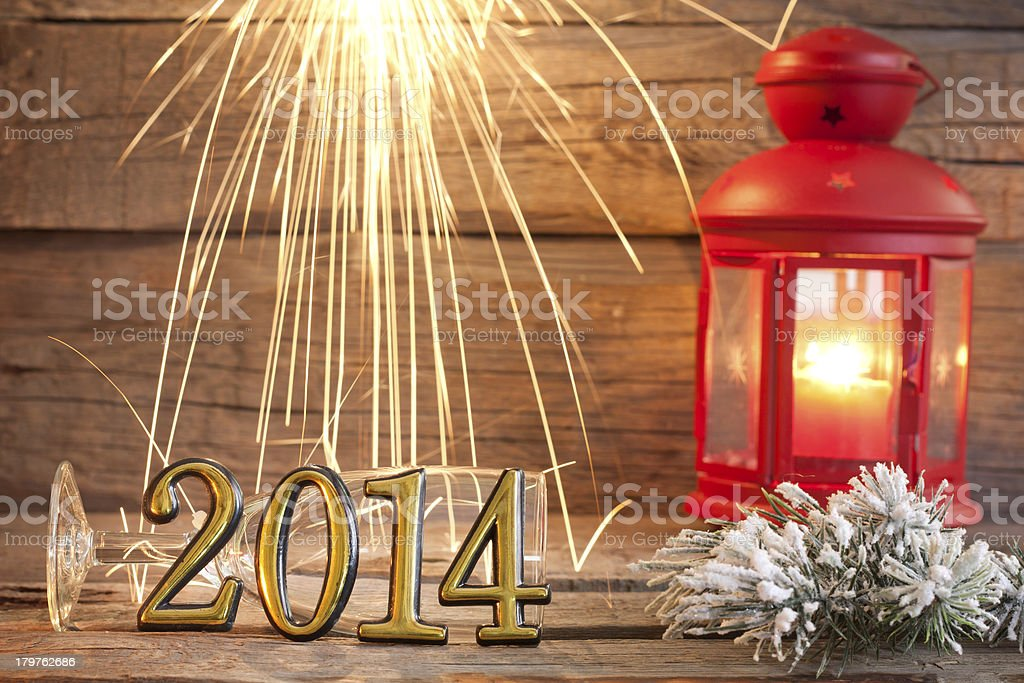 New year 2014 sign with sparklers royalty-free stock photo