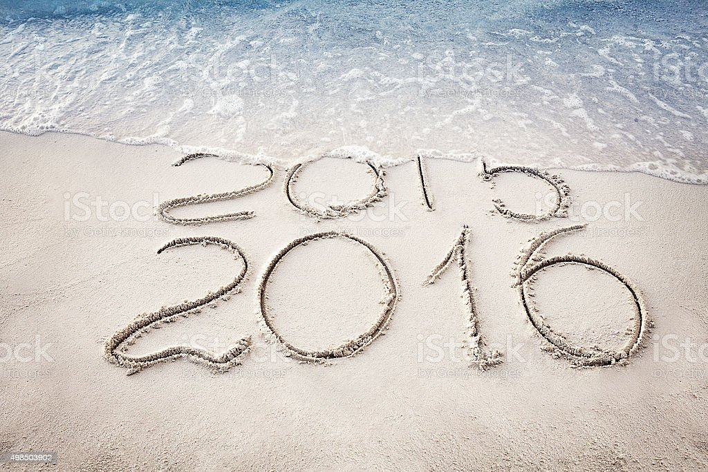 New Year 2016 replace 2015 concept on the sea beach stock photo
